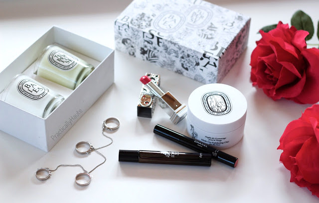 Diptyque beauty flatlay with lipstick and jewelry